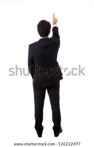 Young male businessman pointing at copyspace over white background