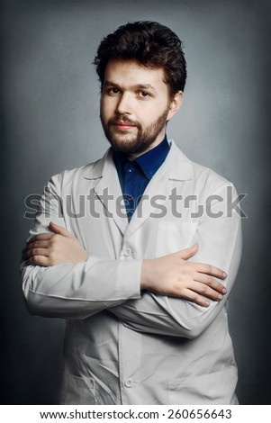 young male doctor chemist bearded man gray vintage background