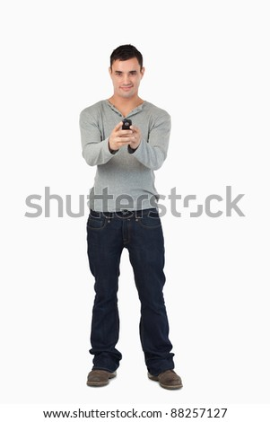 Young male writing text message against a white background
