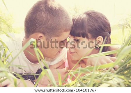 Young man and woman tenderly looking at each other