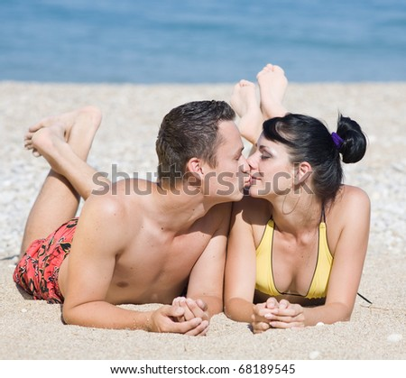 Young man and young woman on the beach