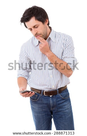Young man at the phone, isolated over white background