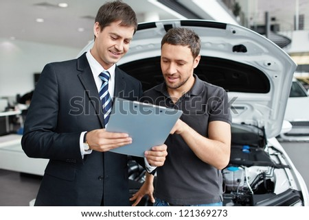 Young man buys a car