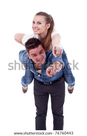 Young man carrying his cute girl on back. woman and pointing to you