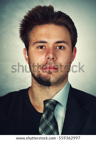 Young man clean and dirty parts of face concept. Well cared part of face with business clothing and messy part with casual style.