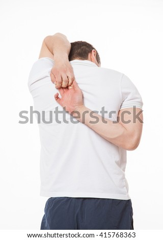 Young man doing stretching befor training, white background