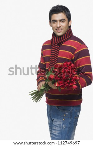 Young man holding a bouquet of roses