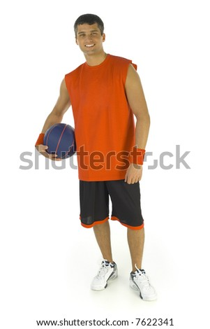 Young man holding basketball in hand. He's smiling and looking at camera. Isolated on white background, front view.