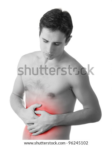 young man holding his sick stomach in pain, isolated on white background, monochrome photo with red as a symbol for the hardening