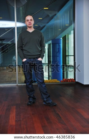 young man in casual clothing posing indoor