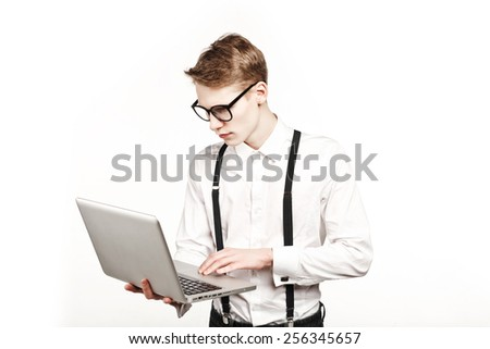 young man in glasses with laptop with emotion on white background