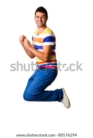 Young man jumping high in the air with joy