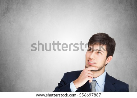 Young man looking up. Large bright background copy-space
