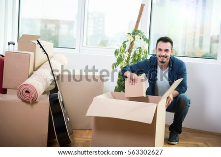 couple love moving into new apartment stock photo 563302462 shutterstock. Black Bedroom Furniture Sets. Home Design Ideas