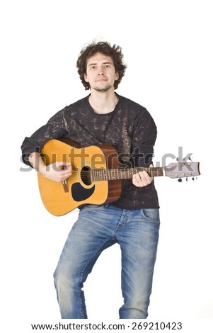 Young man playing acustic guitar.