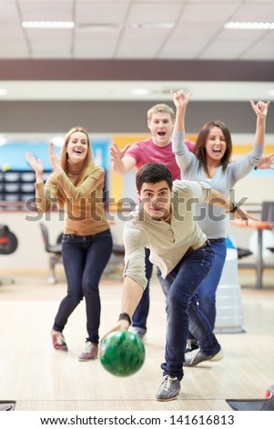 Young man playing bowling