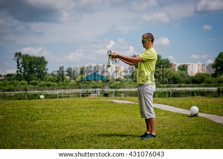 Young man prepares a drone to a flight