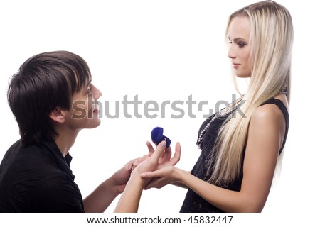 young man holding valentine gift in his hand stock