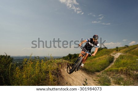 young man riding a bike in the mountains
