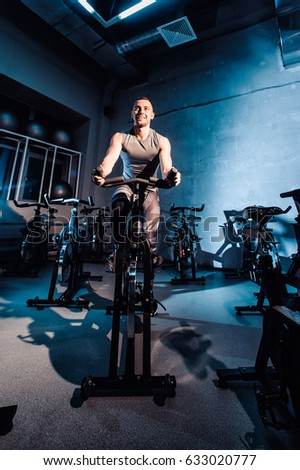 Young Man Riding Exercise Bike Guy Stock Photo 633020969