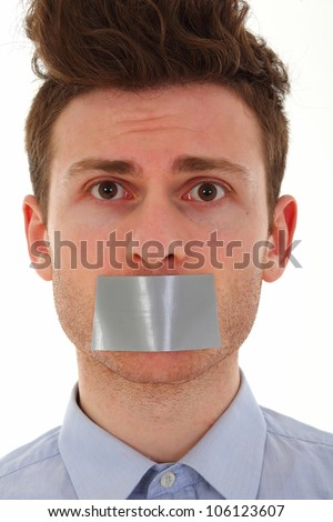 Young man scared with tape on mouth