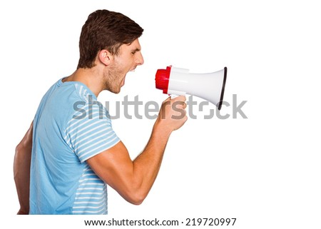 Young man shouting through megaphone on white background