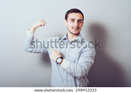 young man shows biceps