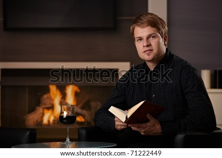 Young Man Sitting Front Fireplace Home Stock Photo 62680990 ...
