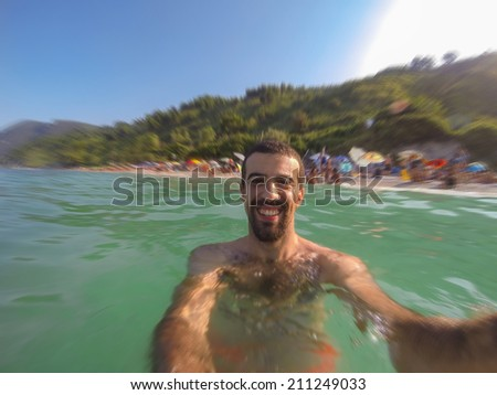 Young Man Taking Selfie in the Water