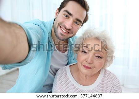 Nurse Reading Book Elderly Woman On Stock Photo 582465571 ...