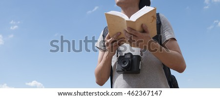 young man traveler is taking picture with the guide book , travel and recreation concept