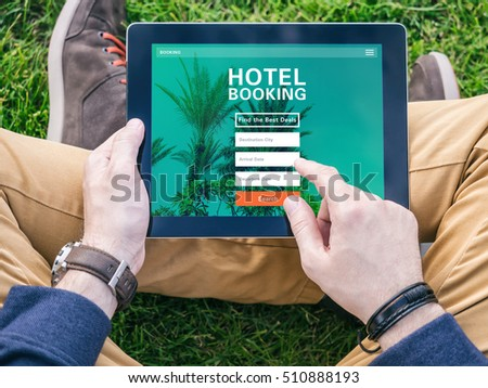 Hand holding mobile smartphone message on stock photo for Tablet hotel booking