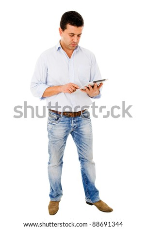 Young man using a tablet computer against a white background