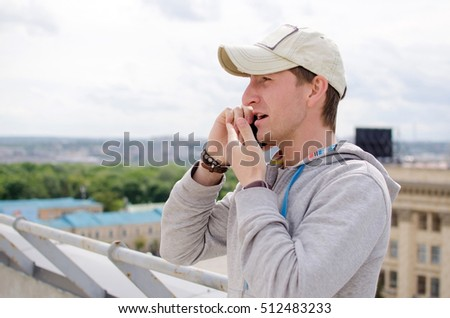Young man using his black cell phone