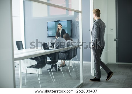 Young man walking into office