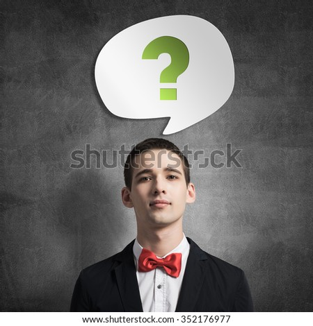 Young man wearing red bowtie and thought bubble above his head