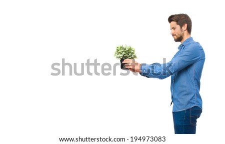young man with a plant