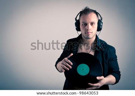 Antes fossem os meus audiófilos... - Página 3 Stock-photo-young-man-working-as-dj-with-ear-phones-and-disc-98643053