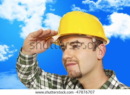 young manual worker look forward and cloudy sky