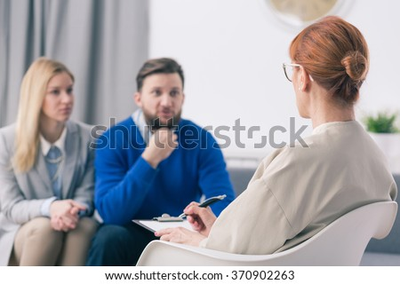 Young marriage with problems during session with counselor
