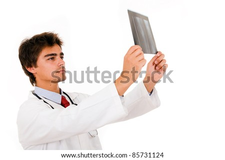 Young medical doctor analyses an x-ray, isolated on white.