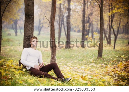 young men in autumn park
