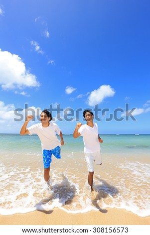Young men on beach