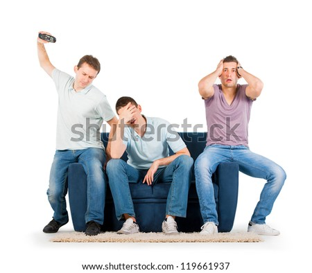 Young men sitting on a sofa disappointed, on white background