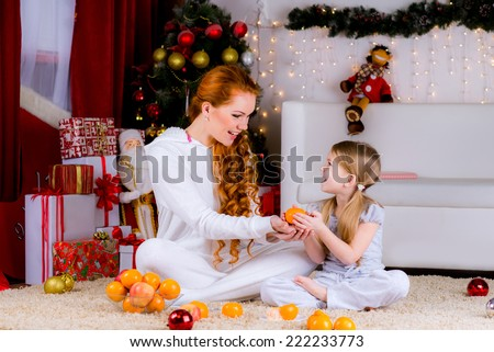 Young mother and her daughter on Christmas