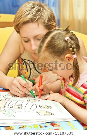 young  mother and her daughter painting