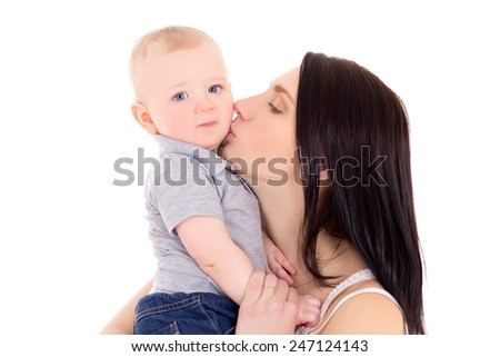 young mother kissing her little son isolated on white background
