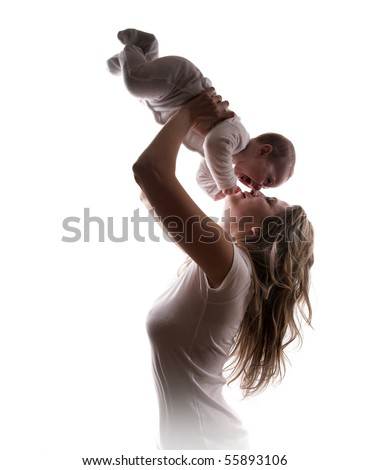 Young mother lifts her baby up