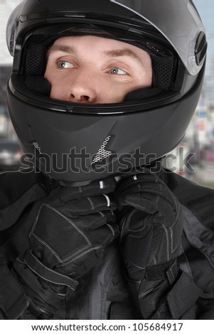 young motorcyclist man wearing helmet