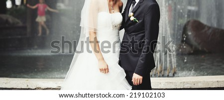 Young newly wed couple together on happy wedding day.